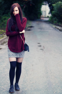 Teen girl wearing black over the knee socks