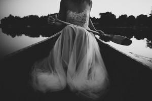 Beautiful bride in rowing boat
