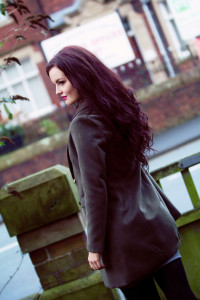 Girl wearing olive green winter coat