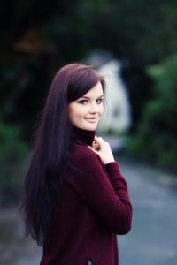 Teen girl looking back over shoulder