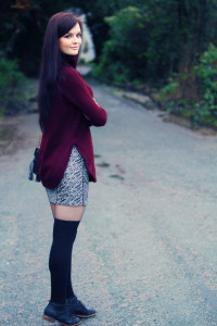 Teen wearing red rollneck and patterned bodycon skirt