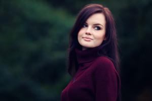 Brunette teen wearing plum coloured rollneck top from New Look