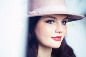 Brunette girl wearing dusty pink fedora hat