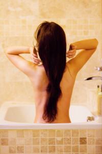 Brunette haired girl in bath