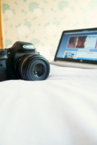 canon DSLR camera and laptop