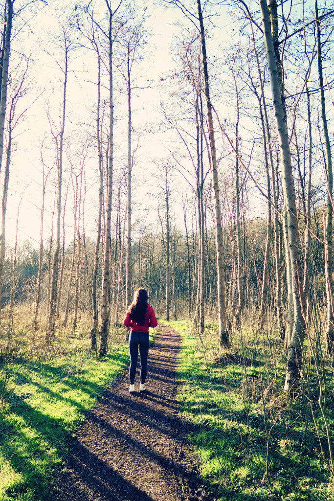 girl-walking-down-path-in-woods