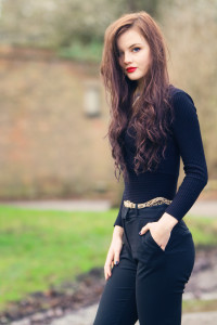 Teen girl with red lipstick and black top and trousers