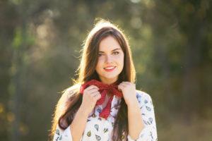 Teen wearing white shirt and bandana scarf