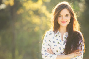 Backlit portrait of smiling teen