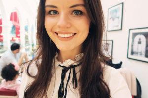 smiling teen wearing cream blouse