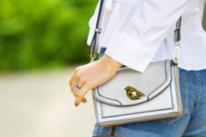 Teen wearing bird detail handbag