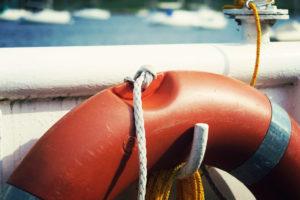 Red lifesaver belt on boat