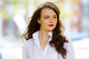 Teenage brunette girl wearing red lipstick