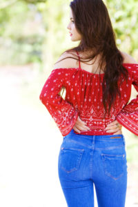 Back view of teen girl in jeans and red top