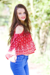 Smiling girl wearing red and white top