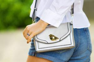 Close up of silver bird detail handbag