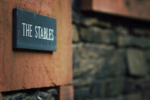 slate sign the stables