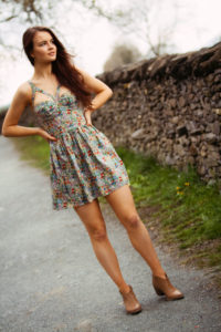 Girl wearing Top Shop dress and western ankle boots