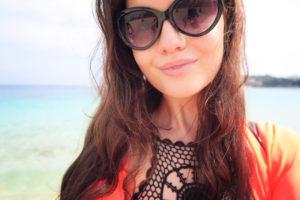 Girl wearing sunglasses on beach