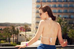 White chrochet bikini. Balcony shot