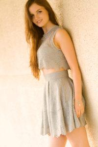 Brunete teen wearing grey lace dress