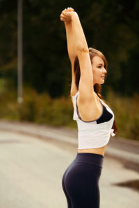 Arms above head stretch. Fitness
