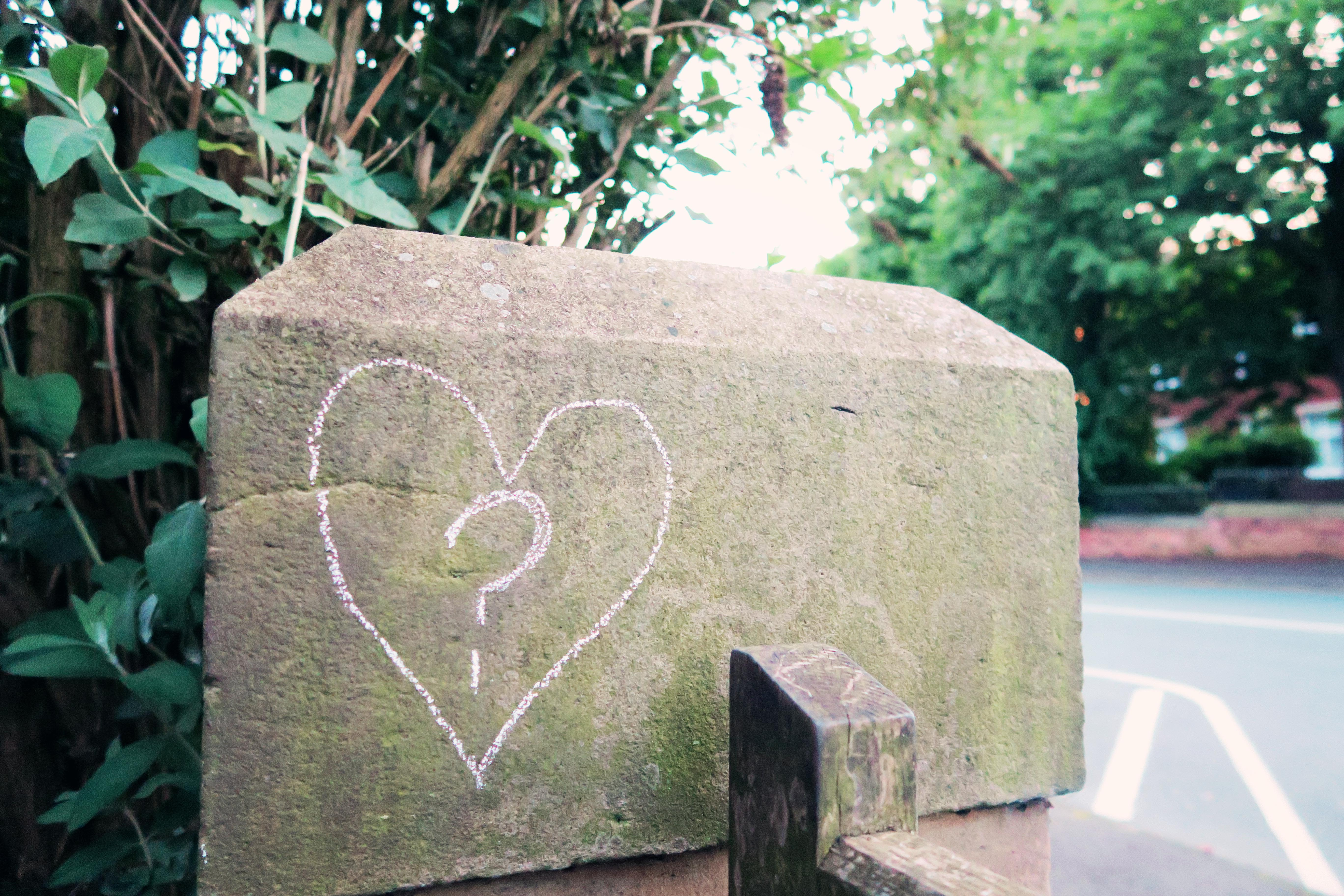 Heart drawn in chalk on gatepost