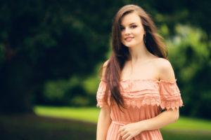 Smiling picture of girl in feminine dress