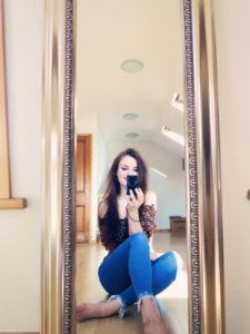 Teen blogger looking in mirror