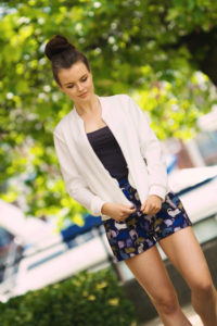 Zipping up bomber jacket. Teen outfit