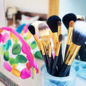 Brand new makeup brushes in pot. Spotted makeup bag