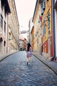 Blogger walking along cobbled street in Budapest