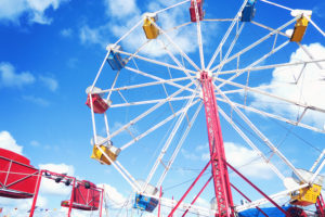 Ferris wheel against very blue sky.