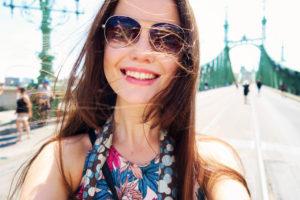 Teen girl on Freedom/Liberty bridge Budapest, Hungary. Teen girl with windblown hair and aviator sunglasses.
