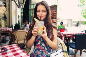 Girl drinking lemonade in Budapest, Hungary