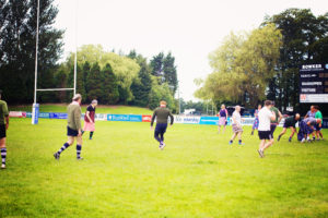 Men playing rugby in dresses!