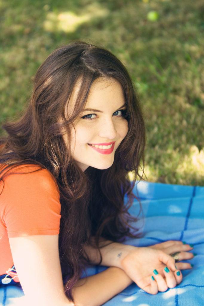 smiling-brunette-teen-picnic-blanket