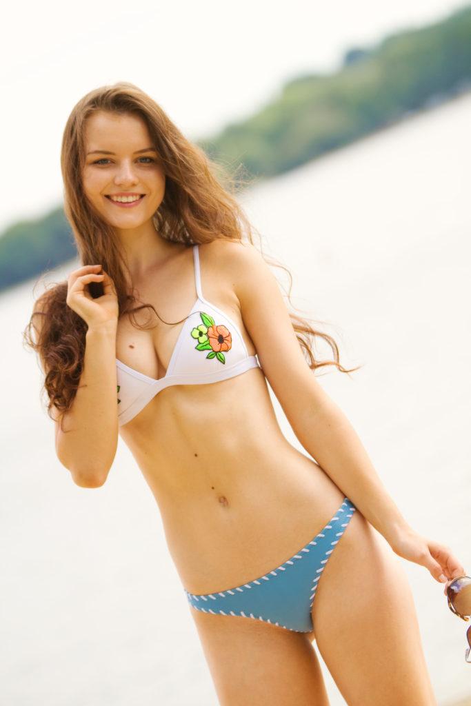 smiling-teen-wearing-triangl-bikini