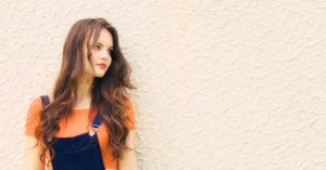 Brunette wearing dungarees and Bardot top. Teen outfit