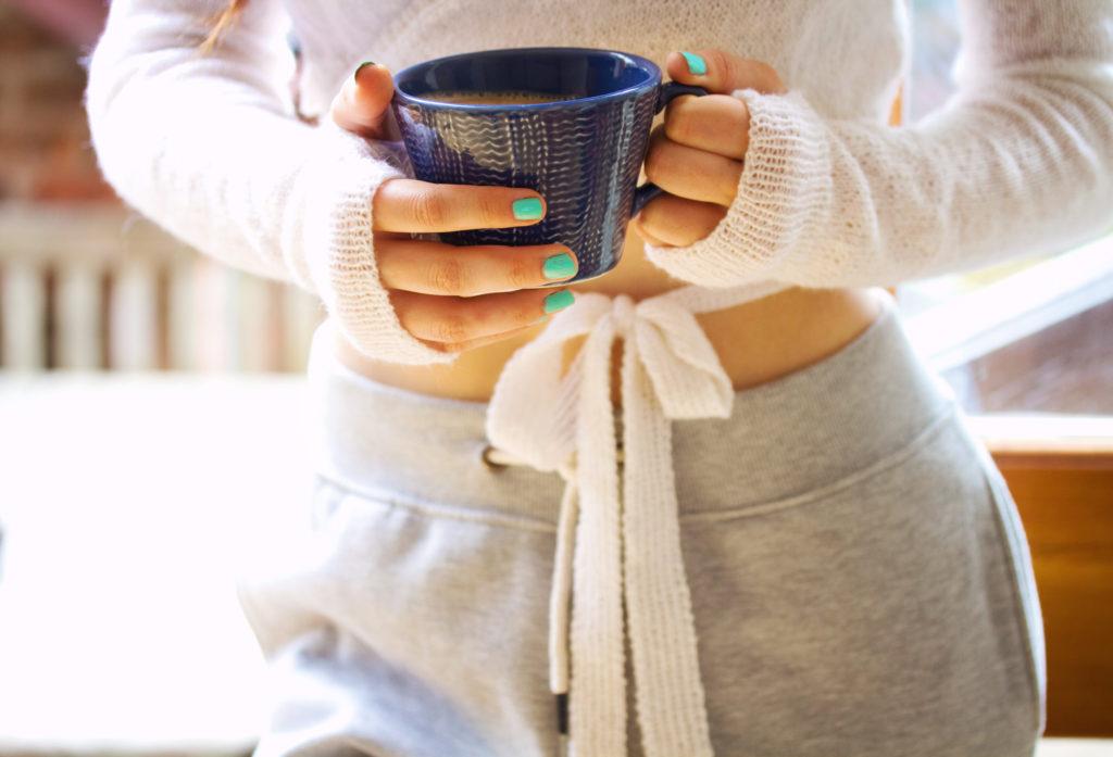 teen-girl-holding-coffee-cup
