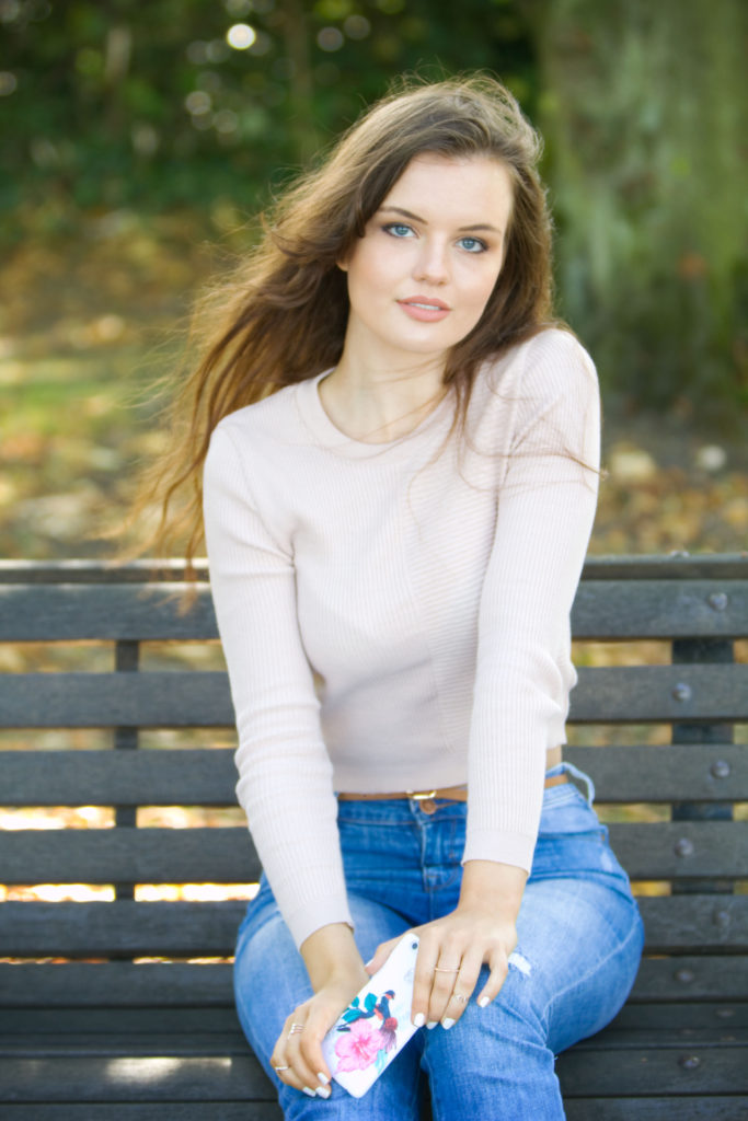 teen-girl-sitting-on-park-bench