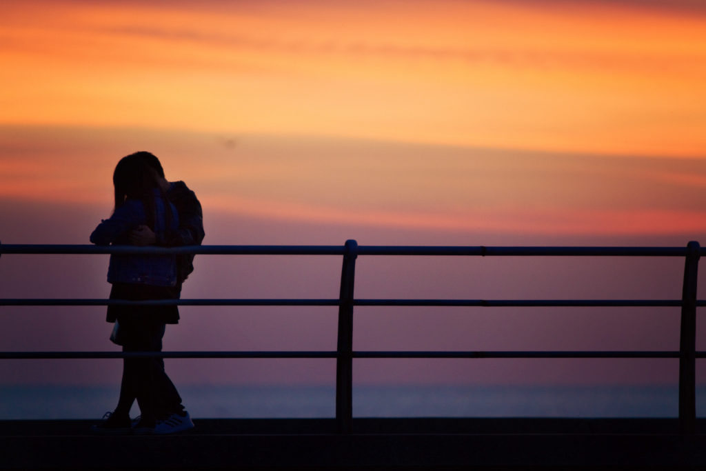 cute-young-couple-watching-sunset