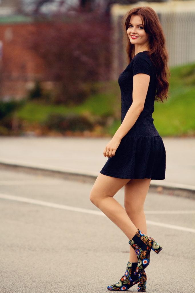 teen-girl-wearing-black-dress