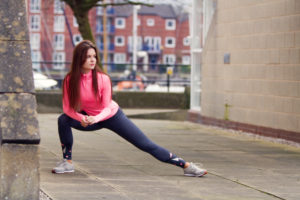 Girl doing side lunges