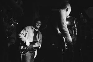 Black and white photo of young vocalist and guitarist. The Empire Police. Preston