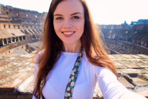 Female tourist at Colosseum Rome Italy