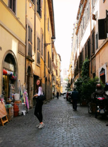 Narrow side street in Rome Italy. Yellow buildings.
