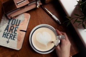 Heart shaped latte art on coffee.