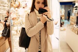 Girl taking photograph in mirror. Canon G7x camera.