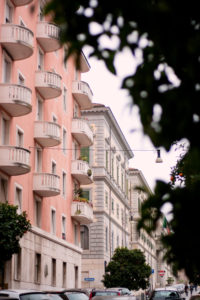 Pink building with balconies in Rome Italy.